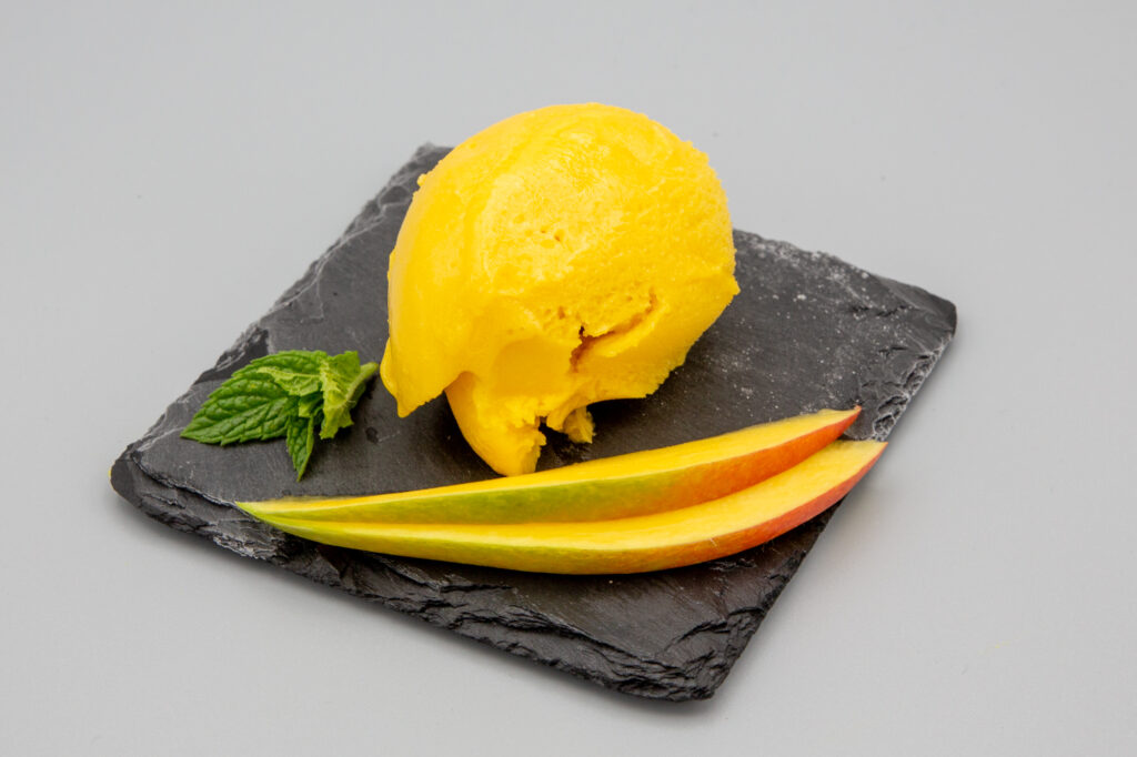 Mango sorbet with mango wedges