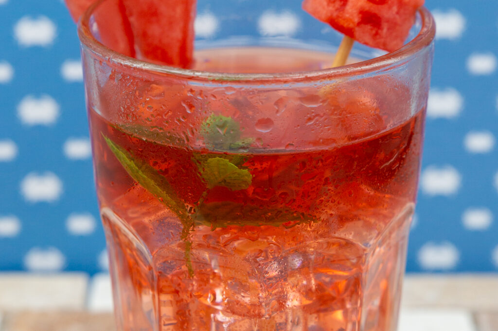 Fruit ice tea decorated with watermelon and mint