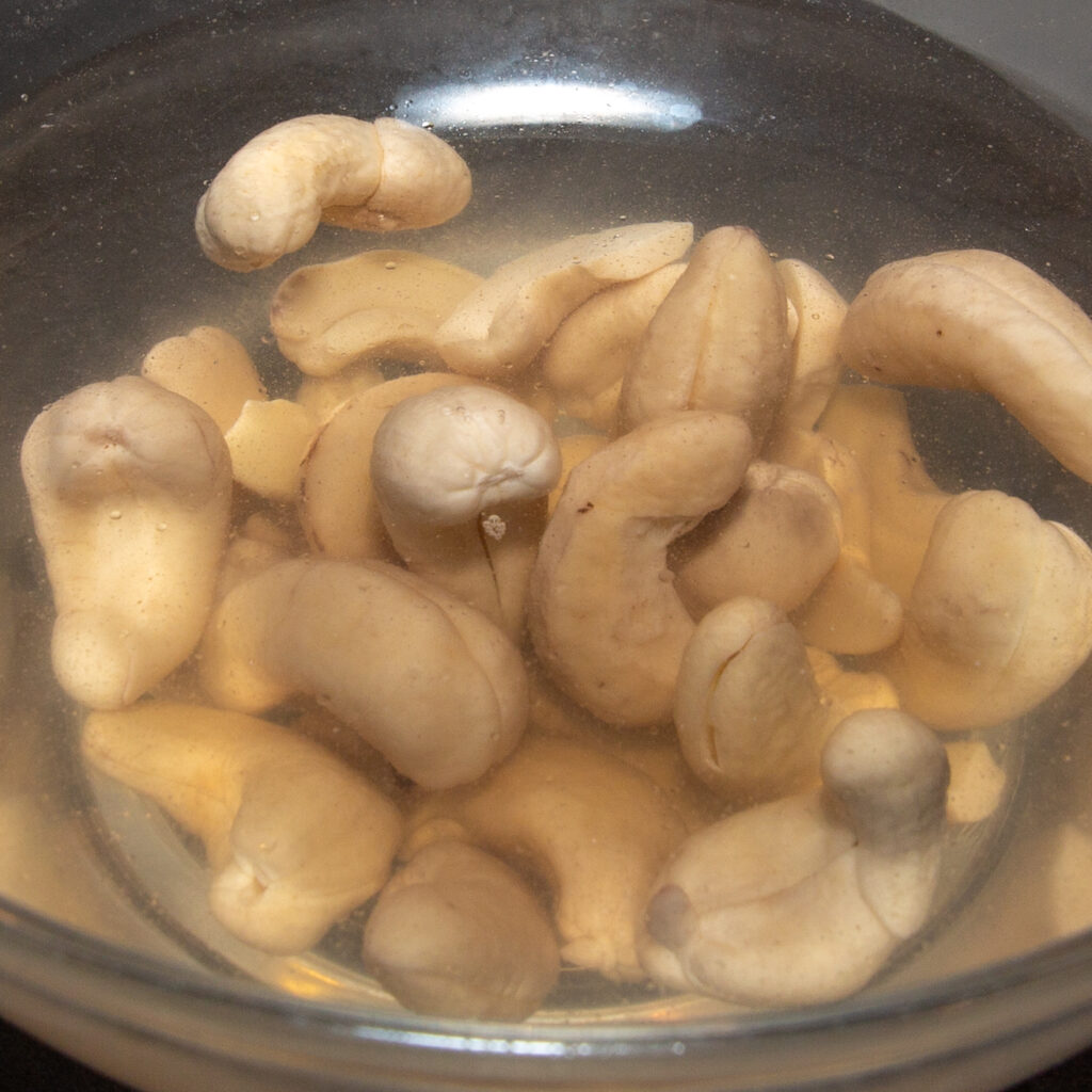 Soak cashews in hot water for one hour.