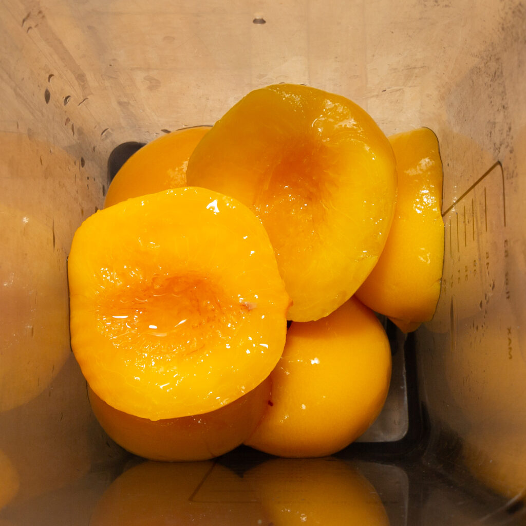 Peeled peach halves in a blender.